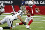 Arizona Cardinals quarterback Kyler Murray (1) scrambles as Oakland Raiders defensive back Johnathan Abram (24) defends during the first half of an an NFL football game, Thursday, Aug. 15, 2019, in Glendale, Ariz. (AP Photo/Rick Scuteri)