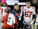 Mississippi head coach Matt Luke, center, talks offensive lineman Alex Givens (67) in the first half of an NCAA college football game against Vanderbilt, Saturday, Nov. 17, 2018, in Nashville, Tenn. (AP Photo/Mark Humphrey)