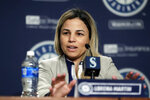 FILE - In this Jan. 25, 2018, file photo, Lorena Martin, Seattle Mariners' director of high performance, speaks during the Mariners annual media briefing before the start of spring training baseball, in Seattle. Major League Baseball's independent investigation found no credible evidence to support claims of disparaging comments and discriminatory treatment by members of the Seattle Mariners front office. MLB said in a statement Wednesday, Feb. 6, 2019, that the investigation found the Mariners did not violate baseball's