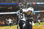 Tennessee Titans running back Dalyn Dawkins (28) celebrates with wide receiver Anthony Ratliff-Williams after Dawkins' touchdown reception during the first half of the team's NFL preseason football game against the Chicago Bears, Thursday, Aug. 29, 2019, in Chicago. (AP Photo/David Banks)