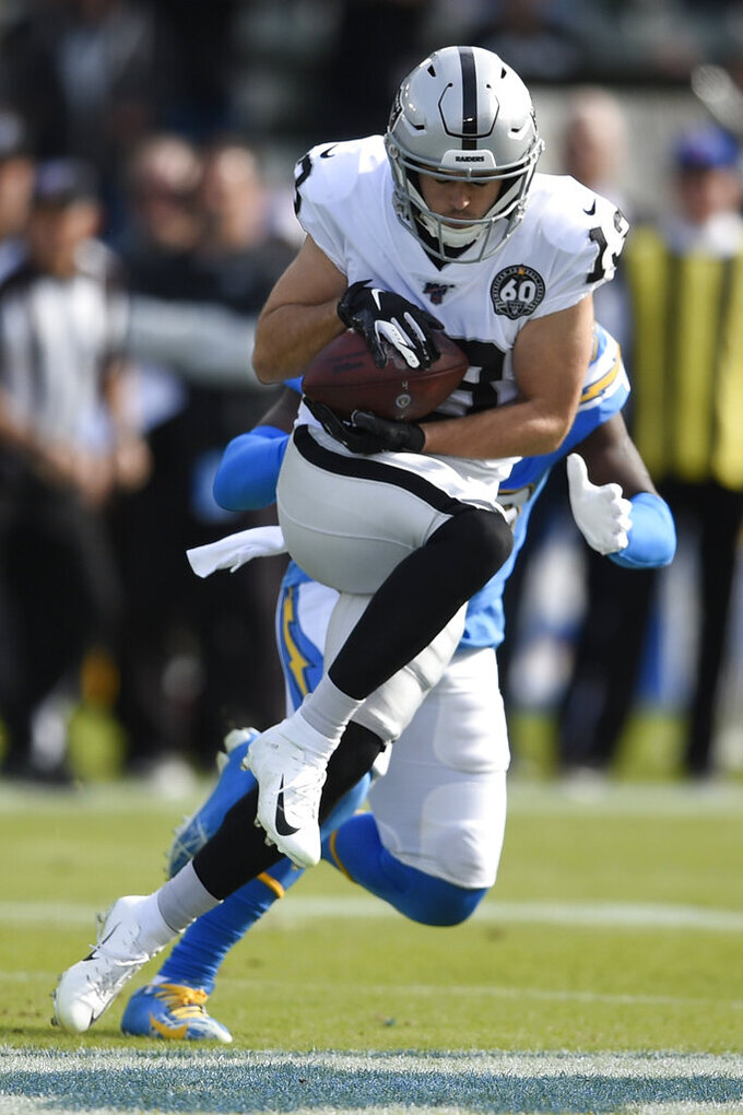 Oakland Raiders wide receiver Hunter Renfrow catches a touchdown pass in front of Los Angeles Chargers defensive back Desmond King during the first half of an NFL football game Sunday, Dec. 22, 2019, in Carson, Calif. (AP Photo/Kelvin Kuo)