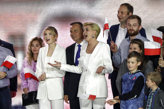 FILE - This Sunday, July 12, 2020 file photo shows Polish President Andrzej Duda joined by with wife Agata Kornhauser-Duda, right, and daughter Kinga Duda, on the night of his re-election, in Pultusk, Poland. Duda has appointed his 25-year-old daughter as an unpaid adviser on social issues, a move that has triggered accusations of nepotism.(AP Photo/Czarek Sokolowski, File)