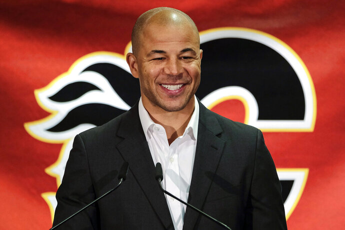 FILE - In this July 30, 2018, file photo, former Calgary Flames hockey team captain Jarome Iginla announces his retirement from the NHL at a news conference in Calgary, Alberta. Iginla, the first Black player to lead the NHL in points and goals and to win an Olympic gold medal, is expected to headline the Hockey Hall of Fame's 2020 induction class, to be announced Wednesday, June 24, 2020. (Jeff McIntosh/The Canadian Press via AP, File)