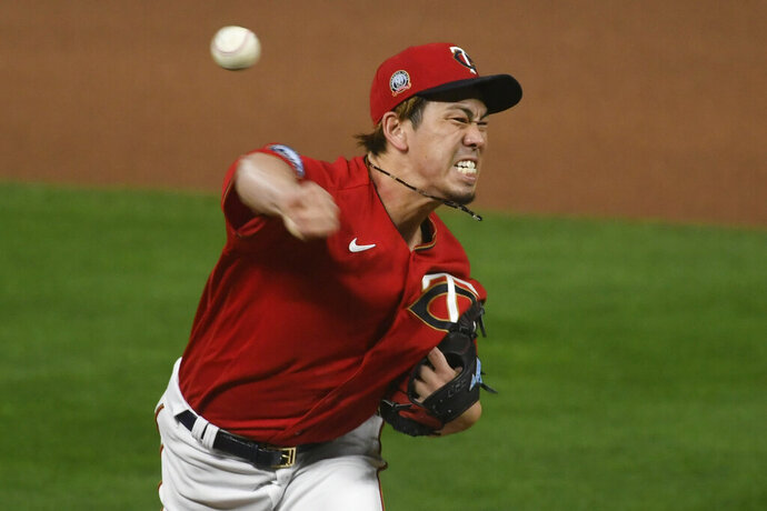 Minnesota Twins starting pitcher Kenta Maeda throws to a Cleveland Indians batter during the first inning of a game Friday, Sept. 11, 2020, in Minneapolis. (AP Photo/Craig Lassig)