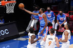 Brooklyn Nets forward Kevin Durant (7) goes to the basket past Orlando Magic forward Dwayne Bacon (8) center Nikola Vucevic (9) and center Khem Birch (24) during the second half of an NBA basketball game, Saturday, Jan. 16, 2021, in New York.  (AP Photo/Mary Altaffer)