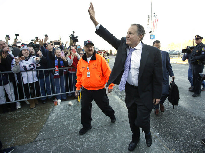 New England Patriots head coach Bill Belichick, center right, waves to fans following the football teams arrival at Gillette Stadium, Monday, Feb. 4, 2019, in Foxborough, Mass., after defeating the Los Angeles Rams Sunday in NFL Super Bowl 53, in Atlanta, Ga. (AP Photo/Steven Senne)