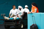 Miami Dolphins wide receiver Preston Williams (18) is taken away after an injury during the second half of an NFL football game against the New York Jets, Sunday, Nov. 3, 2019, in Miami Gardens, Fla. (AP Photo/Wilfredo Lee)