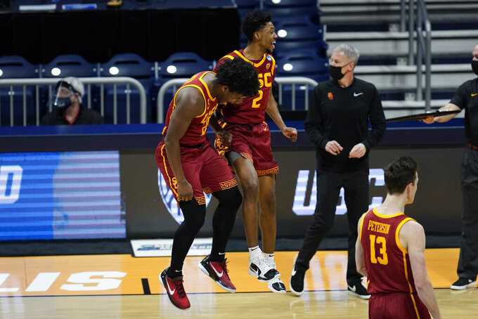 USC guard Ethan Anderson (20) and Tahj Eaddy (2) react after a basket against Kansas during the first half of a men's college basketball game in the second round of the NCAA tournament at Hinkle Fieldhouse in Indianapolis, Monday, March 22, 2021. (AP Photo/Paul Sancya)