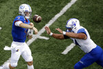 Kansas quarterback Carter Stanley (9) passes under pressure from Indiana State defensive lineman Kaleb Brewer (54) during the second half of an NCAA college football game Saturday, Aug. 31, 2019, in Lawrence, Kan. Kansas won 24-17. (AP Photo/Charlie Riedel)