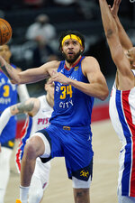 Denver Nuggets center JaVale McGee (34) makes a layup as Detroit Pistons center Jahlil Okafor defends during the first half of an NBA basketball game, Friday, May 14, 2021, in Detroit. (AP Photo/Carlos Osorio)