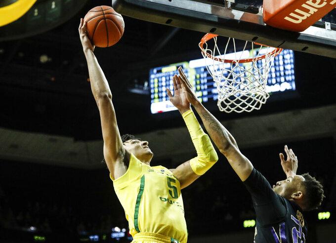 Oregon forward Miles Norris (5), shoots against Washington forward Dominic Green (22) during an NCAA college basketball game Thursday, Jan. 24, 2019, in Eugene, Ore. (AP Photo/Thomas Boyd)