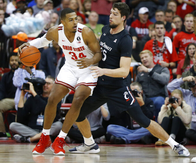 Ohio State's Kaleb Wesson, left, posts up against Cincinnati's Jaume Sorolla during the first half of an NCAA college basketball game Wednesday, Nov. 6, 2019, in Columbus, Ohio. (AP Photo/Jay LaPrete)