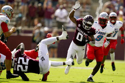 Texas A&M wide receiver Ainias Smith (0) dives for yardage against New Mexico during the during the first quarter of an NCAA college football game on Saturday, Sept. 18, 2021, in College Station, Texas. (AP Photo/Sam Craft)
