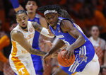 Memphis forward Precious Achiuwa (55) works for a shot as he's defended by Tennessee guard Lamonte Turner (1) during the first half of an NCAA college basketball game Saturday, Dec. 14, 2019, in Knoxville, Tenn. (AP Photo/Wade Payne)