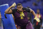 FILE - In this March 3, 2019, file photo, Clemson defensive lineman Clelin Ferrell runs a drill at the NFL football scouting combine, in Indianapolis. Ferrell is a possible pick in the 2019 NFL Draft. (AP Photo/Michael Conroy, File)
