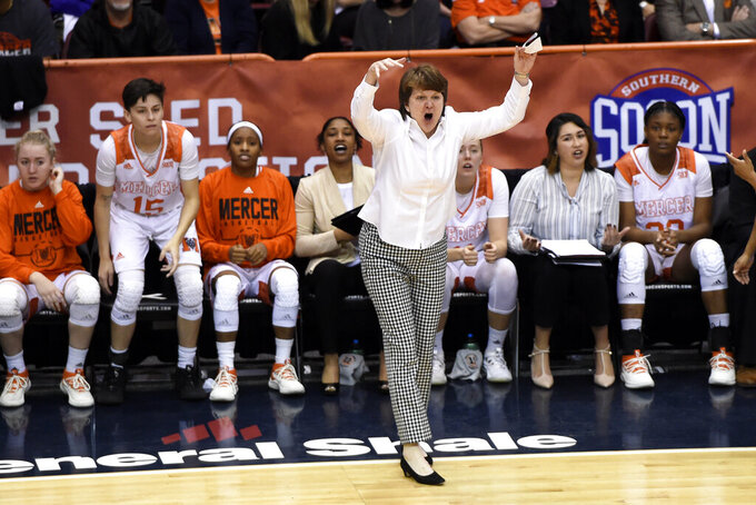 Mercer Bears head coach Susie Gardner, center, directs her team in the first half of an NCAA college basketball game for the Southern Conference women's tournament championship against Furman, Sunday, March 10, 2019, in Asheville, N.C. (AP Photo/Kathy Kmonicek)