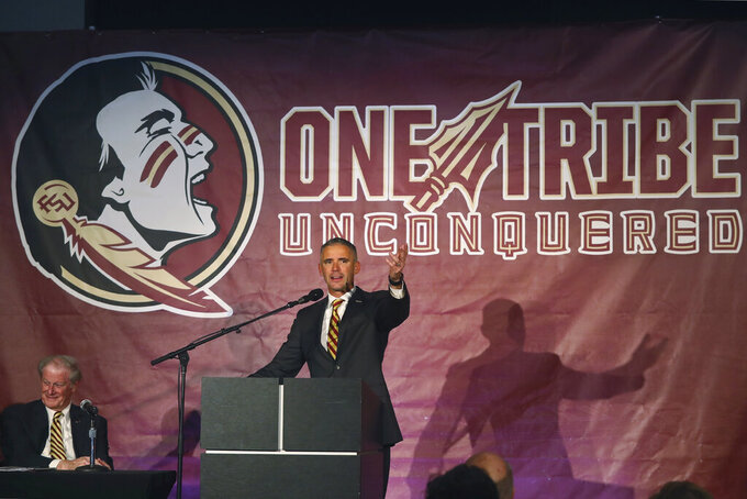 Florida State head football coach Mike Norvell answers a question at a news conference Sunday, Dec. 8, 2019, in Tallahassee, Fla. Norvell is Florida State's new coach, taking over a Seminoles program that has struggled while he was helping to build Memphis into a Group of Five power. (AP Photo/Phil Sears)