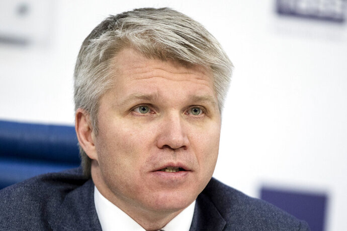 FILE - In this Feb. 5, 2018 file photo, Russia's sports minister Pavel Kolobkov attends a press conference in Moscow, Russia.  Speeches by representatives from the U.S. and Russia delivered Wednesday, Nov. 6, 2019, in Poland, illustrated the wide gap in perceptions about the Russian doping scandal that has upended Olympic sports. U.S. Anti-Doping Agency head Travis Tygart said Russia can no longer be allowed to steal medals from clean athletes. A few minutes later, Kolobkov said Russia has paid the price for its misdeeds and should be welcomed back into the fold. Russia is under threat of missing the Tokyo Olympics.  (AP Photo/Pavel Golovkin, File)