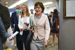 Sen. Susan Collins, R-Maine, arrives as senators rush to the chamber for votes ahead of the approaching Memorial Day recess, at the Capitol in Washington, Wednesday, May 26, 2021. Lawmakers still face standoffs on an infrastructure bill, police reform, voting rights, and a bipartisan commission to investigate the Jan. 6 attack on the Capitol. (AP Photo/J. Scott Applewhite)