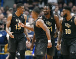Central Florida's Aubrey Dawkins (15) celebrates his basket with teammates BJ Taylor (1), Chad Brown (21) and Dayon Griffin (10) during the second half of an NCAA college basketball game against Connecticut, Saturday, Jan. 5, 2019, in Hartford, Conn. (AP Photo/Jessica Hill)