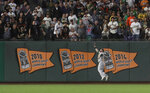 Oakland Athletics left fielder Robbie Grossman cannot catch an RBI double hit by San Francisco Giants' Kevin Pillar during the sixth inning of a baseball game in San Francisco, Tuesday, Aug. 13, 2019. (AP Photo/Jeff Chiu)