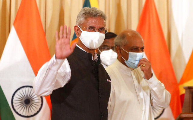 Indian Foreign Minister Subrahmanyam Jaishankar waves to the media as he leaves with his Sri Lankan counterpart Dinesh Gunawardena after addressing a joint media briefing in Colombo, Sri Lanka, Wednesday, Jan. 6, 2021. (AP Photo/Eranga Jayawardena)