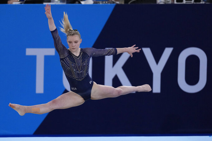Jade Carey, of the United States, performs on the floor during the artistic gymnastics women's all-around final at the 2020 Summer Olympics, Thursday, July 29, 2021, in Tokyo. (AP Photo/Ashley Landis)