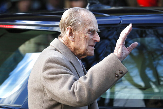 FILE - In this Sunday, Dec. 25, 2016 file photo, Britain's Prince Philip waves to the public as he leaves after attending a Christmas day church service in Sandringham, England. Buckingham Palace says Prince Philip the husband of Queen Elizabeth II had been in a traffic accident and is not injured. The palace said the accident happened Thursday, Jan. 17, 2019 afternoon near the queen's country residence in Sandringham in eastern England. (AP Photo/Kirsty Wigglesworth, file)