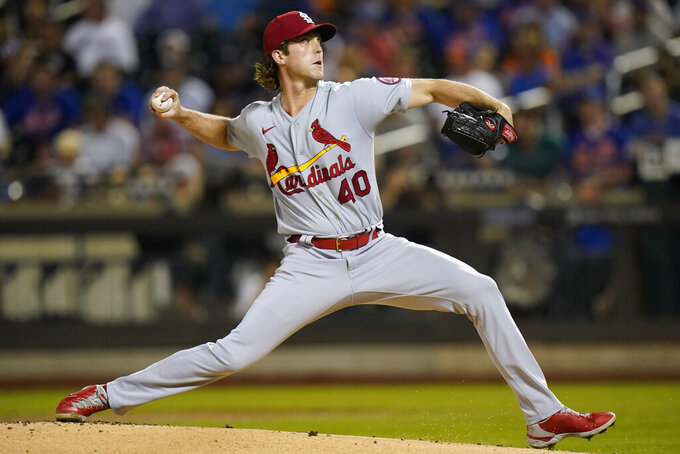 St. Louis Cardinals' Jake Woodford delivers a pitch during the first inning of the team's baseball game against the New York Mets on Tuesday, Sept. 14, 2021, in New York. (AP Photo/Frank Franklin II)