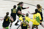 Oregon forward Sedona Prince, center, celebrates with teammates after a college basketball game against Oregon in the second round of the women's NCAA tournament at the Alamodome in San Antonio, Wednesday, March 24, 2021. Oregon won 57-50. (AP Photo/Eric Gay)