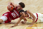 Indiana's Race Thompson, left, recovers a loose ball after diving against Nebraska's Derrick Walker during an NCAA college basketball game on Sunday, Jan. 10, 2021. (Kenneth Ferriera/Lincoln Journal Star via AP)