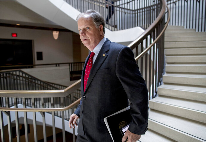 FILE - In this July 10, 2019, file photo, Sen. Doug Jones, D-Ala., arrives for a closed door meeting for Senators on election security on Capitol Hill in Washington. Jones, a Democrat who pulled off a stunning political upset in Alabama two years ago, launched his reelection bid Sunday, Sept. 8, seeking to create another Deep South victory in a Republican-dominated state. (AP Photo/Andrew Harnik, File)