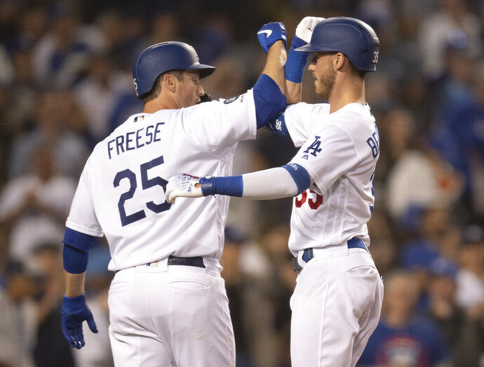 Los Angeles Dodgers' Cody Bellinger, right, celebrates his two-run home run with David Freese during the fourth inning of a baseball game against the Chicago Cubs in Los Angeles, Thursday, June 13, 2019. (AP Photo/Kyusung Gong)