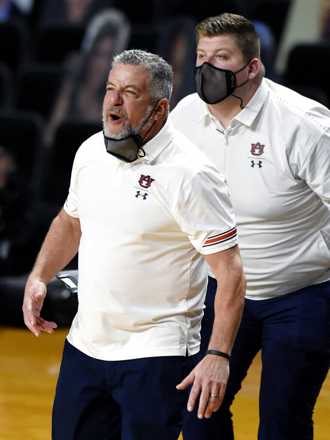 Auburn Tigers head coach Bruce Pearl, left, yells to his players during the second half of an NCAA college basketball game against Vanderbilt Tuesday, Feb. 9, 2021, in Nashville, Tenn. Auburn won 73-67. (AP Photo/Mark Zaleski)