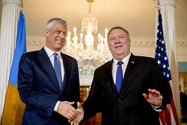 Secretary of State Mike Pompeo, right, and Kosovo President Hashim Thaci, left, shake hands at the State Department, Wednesday, Feb. 26, 2020, in Washington. (AP Photo/Andrew Harnik)