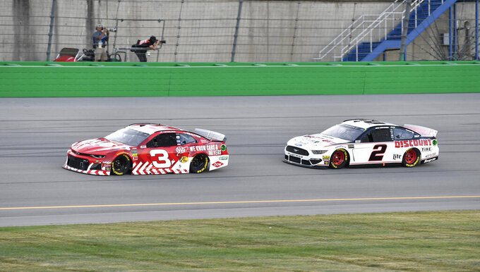 Austin Dillon (3) tries to hold off a challenge from Brad Keselowski (2) during the NASCAR Cup Series auto race at Kentucky Speedway in Sparta, Ky., Saturday, July 13, 2019. (AP Photo/Timothy D. Easley)