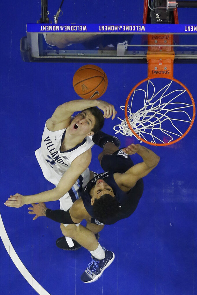 Villanova's Collin Gillespie, left, goes up for a shot against Butler's Jordan Tucker during the second half of an NCAA college basketball game, Saturday, March 2, 2019, in Philadelphia. Villanova won 75-54. (AP Photo/Matt Slocum)