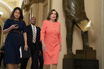 Speaker of the House Nancy Pelosi, D-Calif., walks to her office before voting on a resolution to take legal action against President Donald Trump's administration and potential witnesses, a response to those who defy subpoenas in Congress' Russia probe and other investigations, on Capitol Hill in Washington, Tuesday, June 11, 2019. The House resolution would authorize lawsuits against Attorney General William Barr and former White House counsel Don McGahn for defying subpoenas pertaining to special counsel Robert Mueller's report. (AP Photo/J. Scott Applewhite)