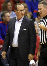 Louisiana Lafayette head coach Bob Marlin talks with an official during the first half of an NCAA college basketball game against Kansas in Lawrence, Kan., Friday, Nov. 16, 2018. (AP Photo/Orlin Wagner)