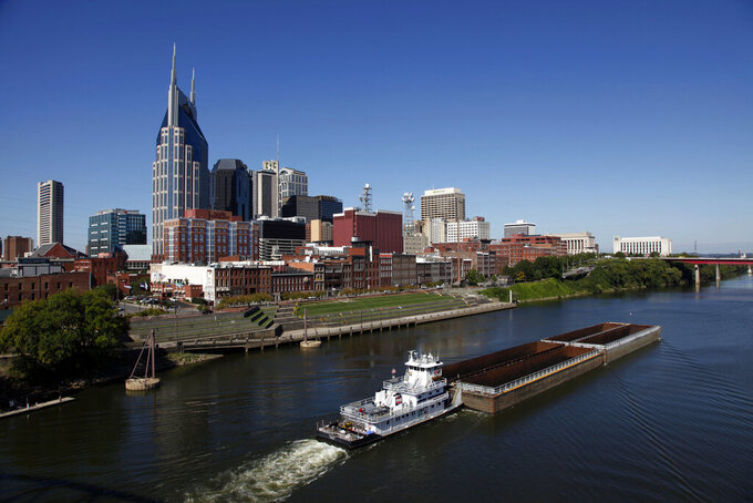 FILE - This Sept. 27, 2011 file photo shows the Cumberland River and downtown Nashville, Tenn. Tennessee paid thousands of dollars for social media influencers to promote a contentious new initiative that uses $2.5 million in taxpayer dollars to offer flight vouchers largely to out-of-state residents. According to documents obtained through a public records request, the Department of Tourist Development paid an estimated $11,000 to at least 11 local influencers to post on Instagram, Facebook and TikTok touting the new program. (AP Photo/Mark Humphrey, File)