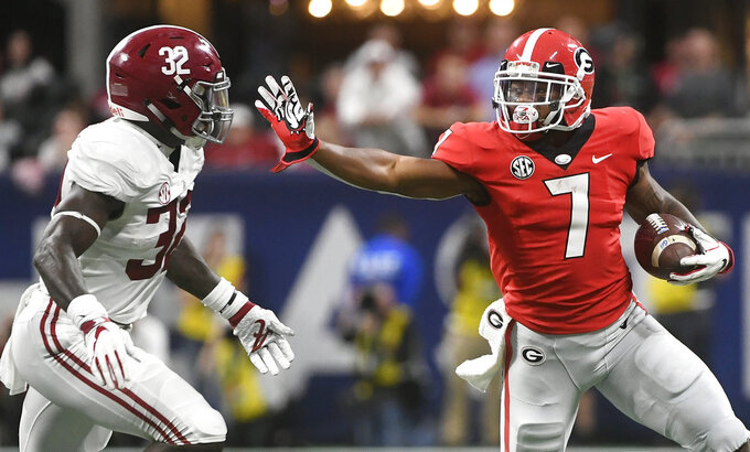 Georgia running back D'Andre Swift (7) runs against Alabama linebacker Dylan Moses (32) during the first half of the Southeastern Conference championship NCAA college football game, Saturday, Dec. 1, 2018, in Atlanta. (AP Photo/John Amis)