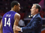 Northwestern head coach Chris Collins talks with guard Ryan Taylor (14) during the first half of an NCAA college basketball game in Champaign, Ill., Sunday, March 3, 2019. (AP Photo/Stephen Haas)