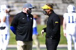 Missouri head coach Eliah Drinkwitz, right, talks with Kentucky head coach Mark Stoops before the start of an NCAA college football game Saturday, Oct. 24, 2020, in Columbia, Mo. (AP Photo/L.G. Patterson)
