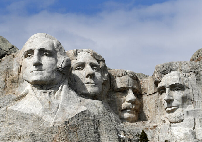 FILE - This March 22, 2019 file photo shows Mount Rushmore in Keystone, S.D. A Nebraska woman has been fined $1,000 for climbing the memorial.  Authorities say Alexandria Incontro scaled the massive granite sculpture Friday, July 12, 2019 with bare feet and no rope, making it to about 15 feet (4.5 meters) from the top.  (AP Photo/David Zalubowski, File)