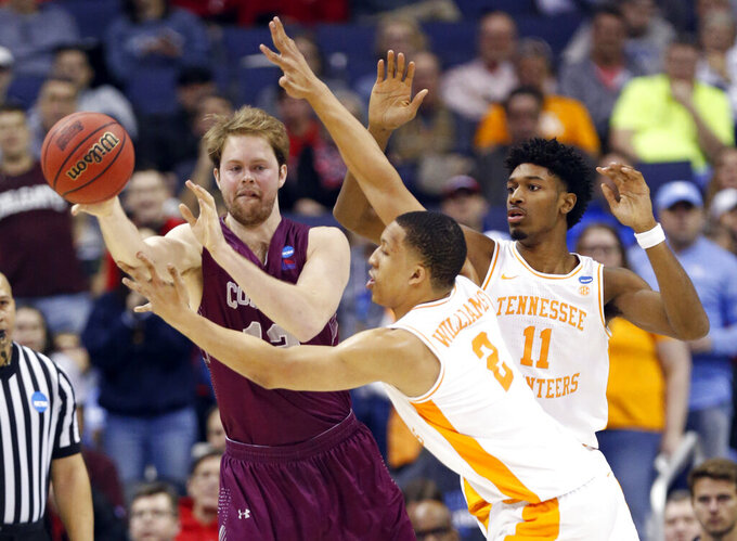 Colgate's Dana Batt (12) passes around Tennessee's Grant Williams (2) and Kyle Alexander (11) in the second half of a first-round game in the NCAA men's college basketball tournament in Columbus, Ohio, Friday, March 22, 2019. Tennessee won 77-70. (AP Photo/Paul Vernon)