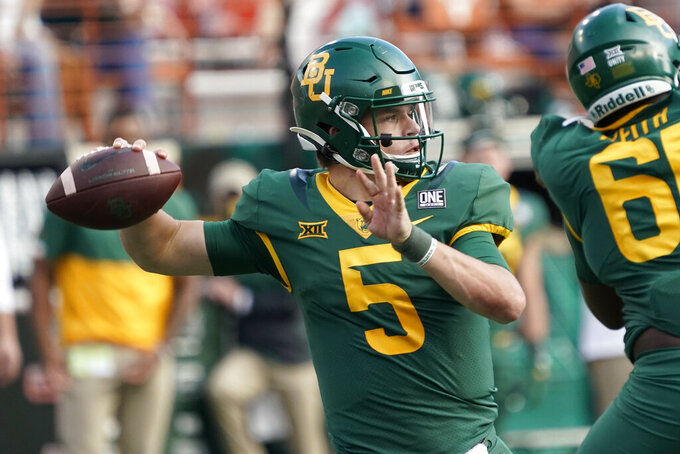 Baylor's Charlie Brewer (5) looks to pass against Texas during the second half of an NCAA college football game in Austin, Texas, Saturday, Oct. 24, 2020. (AP Photo/Chuck Burton)