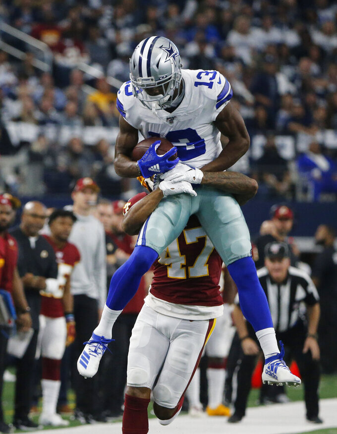 Dallas Cowboys wide receiver Michael Gallup (13) make a catch over Washington Redskins cornerback Aaron Colvin (47) during the first half of an NFL football game in Arlington, Texas, Sunday, Dec. 15, 2019. (AP Photo/Michael Ainsworth)