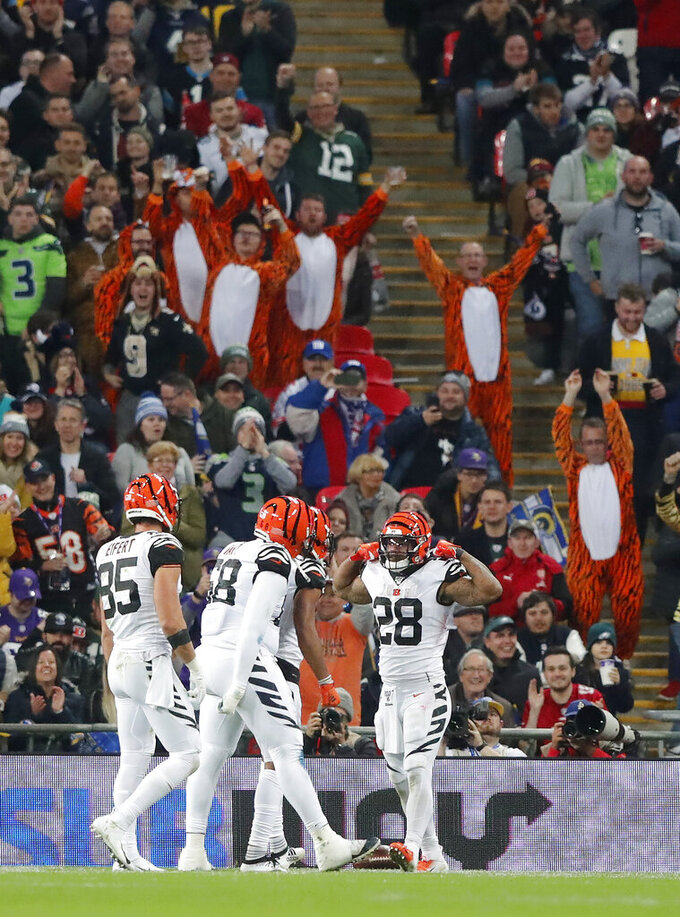 Cincinnati Bengals fans cheer as running back Joe Mixon (28) celebrates with teammates after scoring against the Los Angeles Rams during the first half of an NFL football game, Sunday, Oct. 27, 2019, at Wembley Stadium in London. (AP Photo/Frank Augstein)