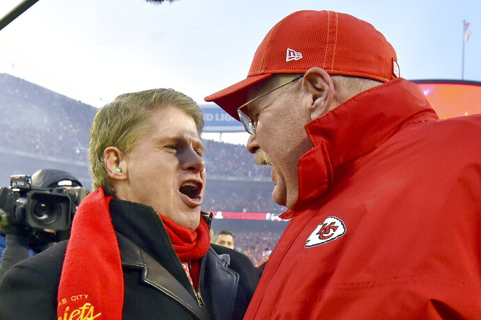 Clark Hunt, part owner, chairman and CEO of the Kansas City Chiefs, left, celebrates with Kansas City Chiefs head coach Andy Reid after the NFL AFC Championship football game against the Tennessee Titans Sunday, Jan. 19, 2020, in Kansas City, MO. The Chiefs won 35-24 to advance to Super Bowl 54. (AP Photo/Ed Zurga)