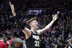 Purdue center Matt Haarms (32) celebrates following a 70-55 win over Indiana in an NCAA college basketball game in West Lafayette, Ind., Saturday, Jan. 19, 2019. (AP Photo/Michael Conroy)